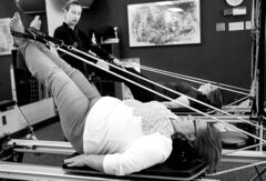 Nicole Mulder, Pilates Instructor at Pilates Manitoba, with sisters Kathryn Mitchell Loewen (foreground) and Margaret Mitchell on a Reformer.