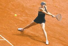 Maria Sharapova of Russia returns in the women's final match against Sara Errani of Italy at the French Open tennis tournament in Roland Garros stadium in Paris, Saturday June 9, 2012. (AP Photo/Michel Spingler)
