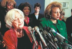Betty Freedan (left), author of The Feminine Mystique, at a Washington press conference in 1998.