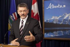 Alberta Finance Minister Doug Horner. The Alberta government's bottom line continues to bleed red ink.