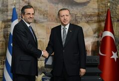 Turkish Prime Minister Recep Tayyip Erdogan, right, and Greek Prime Minister Antonis Samaras shake hands after a joint news conference in Istanbul, Turkey, Monday, March 4, 2013. Samaras is in Istanbul to attend a Turkish-Greek Bussiness forum.(AP Photo)