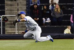 Kansas City Royals right fielder Norichika Aoki goes to his knees catching a line drive hit by San Diego Padres' Kyle Blanks during the seventh inning of a baseball game Tuesday, May 6, 2014, in San Diego. (AP Photo/Lenny Ignelzi)