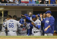 The Los Angeles Dodgers surround Adrian Gonzalez with the