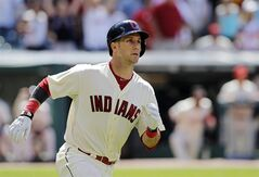 Cleveland Indians' Yan Gomes watches his two-run home run off Chicago White Sox relief pitcher Javy Guerra in the eighth inning of a baseball game Sunday, July 13, 2014, in Cleveland. Gomes' home run gave the Indians a 3-2 win. (AP Photo/Mark Duncan)