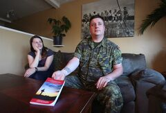 Afghanistan veteran Cpl. Jamie MacWhirter, right, poses for a photo with his wife Vanessa at home in Goulds, N.L. on July 30, 2013. Cpl. Jamie MacWhirter has been through the nightmares and angry outbursts of post-traumatic stress disorder since serving in Afghanistan in 2006. The House of Commons defence committee is urging the military to do more to help soldiers deal with mental health issues. THE CANADIAN PRESS/Paul Daly