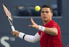 Milos Raonic, of Canada, returns a shot by Jack Sock, of the USA, in men's second round Rogers Cup tennis action in Toronto on Wednesday, August 6, 2014. THE CANADIAN PRESS/Darren Calabrese
