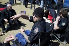 Correctional officers take part in a strike at the Calgary Correctional Centre in Calgary on Saturday April 27, 2013. Workers at detention centres in Alberta have walked off the job, engaging in what the province's justice minister is calling an