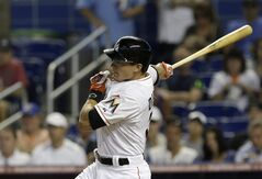 Miami Marlins' Derek Dietrich follows through on a base hit against the Miami Marlins in the first inning of a baseball game in Miami, Wednesday, May 7, 2014. (AP Photo/Alan Diaz)