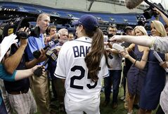 Chelsea Baker, a junior knuckleball pitcher on the Durant, Fla., High School boys baseball team, meets the media after throwing batting practice to members of the Tampa Bay Rays before an interleague baseball game against the Pittsburgh Pirates, Monday, June 23, 2014, in St. Petersburg, Fla. (AP Photo/Chris O'Meara)