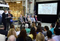Kennedy Space Center Director Robert Cabana, left, and NASA Administrator Charles Bolden talk with International Space Station astronauts Steve Swanson and Reid Wiseman during a ceremony in the Operations and Checkout building at Kennedy Space Center, Fla., to rename the building in astronaut Neil Armstrong's honor, Monday, July 21, 2014. The building was renamed for Apollo astronaut Neil Armstrong. (AP Photo/ Florida Today, Craig Bailey)