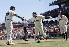 San Francisco Giants' Pablo Sandoval, center, celebrates his two-run home run with teammate Michael Morse, left, during the fifth inning of a baseball game against the Milwaukee Brewers, Sunday, Aug. 31, 2014, in San Francisco. (AP Photo/Marcio Jose Sanchez)