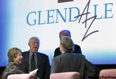Glendale Vice Mayor Steven Frate and Mayor Elaine Scruggs talk with NHL Deputy Commissioner Bill Daly and Phoenix Coyotes General Manager Don Maloney prior to the Glendale City Council meeting Tuesday, May 10, 2011 in Glendale. The City Council voted in favour of a plan to pay the NHL up to $25 million to keep the Phoenix Coyotes for another year.