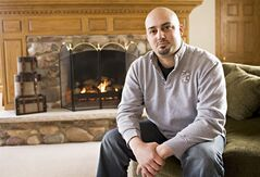 This photo taken in 2011 shows Abe Mashal posing for a photo at his home in St. Charles, Ill. The Obama administration is promising to change the way travelers can ask to be removed from its no-fly list of suspected terrorists banned from air travel. One of the plaintiffs in the Portland lawsuit, Abe Mashal, was unable to print his boarding pass before a flight out of Chicago four years ago. A counter representative told him he was on the no-fly list and would not be allowed to board. Mashal was surrounded by about 30 law enforcement officials, he said. (AP Photo/Sun-Times Media) MANDATORY CREDIT, MAGS OUT,