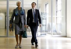International Monetary Fund (IMF) Managing Director Christine Lagarde, left, arrives with Britain's Chancellor George Osborne for a press conference at the HM Treasury, in London, Friday, June 6, 2014. The International Monetary Fund will publish the UK's 2014 Article IV Concluding Statement, the Article IV is the IMF's regular bilateral surveillance of the UK economy and the government's policies. (AP Photo/Kirsty Wigglesworth)