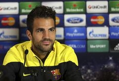 "FILE - A Monday, Sept. 20, 2013 photo from files showing Barcelona's Cesc Fabregas talking to the media during a press conference at Celtic Park, Glasgow, Scotland. Chelsea has announced on its website the signing of Cesc Fabregas from Barcelona on a five-year deal. The 27-year-old Fabregas, who has previously played for Chelsea's London rival Arsenal, says ""I do feel that I have unfinished business in the Premier League"" and that Chelsea ""match my footballing ambitions with their hunger and desire to win trophies."" Fabregas, who is currently with Spain preparing for the World Cup in Brazil, will wear the number four shirt at Chelsea.(AP Photo/Scott Heppell, File)"