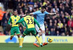 Norwich City's Martin Olsson, center, and Manchester City's Alvaro Negredo, right, battle for the ball during their English Premier League soccer match at Carrow Road, Norwich, England, Saturday, Feb. 8, 2014. (AP Photo/Chris Radburn, PA Wire) UNITED KINGDOM OUT - NO SALES - NO ARCHIVES
