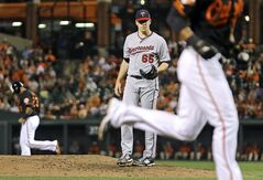 Minnesota Twins starting pitcher Trevor May (65) stands on the mound after walking in Baltimore Orioles' Jimmy Paredes, front right, for a run with the bases loaded in the fourth inning of a baseball game, Friday, Aug. 29, 2014, in Baltimore. (AP Photo/Patrick Semansky)