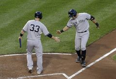 New York Yankees' Stephen Drew, left, greets teammate Francisco Cervelli at home plate after scoring on Cervelli's home run in the third inning of a baseball game against the Baltimore Orioles, Wednesday, Aug. 13, 2014, in Baltimore. (AP Photo/Patrick Semansky)