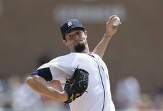 Detroit Tigers starting pitcher Robbie Ray throws during the first inning of a baseball game against the Minnesota Twins in Detroit, Sunday, May 11, 2014. (AP Photo/Carlos Osorio)