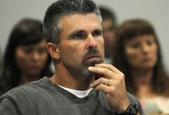 FILE - In this June 22, 2012 file photo, former major league baseball player Chad Curtis appears in Barry County District Court in Hastings, Mich. Curtis says he's innocent of sexual assault allegations made by three teenagers in a lawsuit. The Grand Rapids Press reports Curtis responded on Tuesday, June 24, 2014, in a filing written by his lawyer, Joe Sadler. Curtis is serving seven years to 15 years in state prison on a criminal sexual conduct conviction. (AP Photo/The Grand Rapids Press, Chris Clark, File) LOCAL TV OUT; LOCAL TV INTERNET OUT