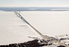 FILE - In this Feb. 11, 2014 aerial file photo is a view of The Mackinac Bridge which spans a 5-mile-wide freshwater channel that separates Michigan's upper and lower peninsulas. Michigan's attorney general and chief environmental regulator have asked the company that owns two oil pipelines stretched beneath the straits, an ecologically sensitive area of the Great Lakes, for evidence that the 61-year-old lines are properly maintained and in good condition. (AP Photo/ Traverse City Record-Eagle, Keith King, Pool)