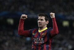 Barcelona's Lionel Messi celebrates after he scores the first goal of the game from a penalty during the Champions League first knock out round soccer match between Barcelona and Manchester City at the Etihad Stadium, Manchester, England, Tuesday Feb. 18, 2014. (AP Photo/Jon Super)