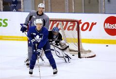 Toronto Maple Leafs forward James van Riemsdyk, left, forward David Steckel, centre, and goalie James Reimer watch the puck down the ice during the team's first day of training camp in Toronto on Sunday, Jan. 13, 2013. THE CANADIAN PRESS/Michelle Siu