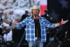 FILE - In this April 7, 2014 file photo shows Toby Keith performs at ACM Presents an All-Star Salute to the Troops in Las Vegas. The New York location of country music star Toby Keith's chain of restaurants owes more than a quarter-million dollars in sales taxes to the state. A tax warrant filed by the state earlier this month seeks $107,000 owed by Keith's I Love this Bar & Grill at the Destiny USA shopping mall in Syracuse. Keith's Syracuse bar, which opened last year, also owes more than $145,000 in sales taxes from earlier in 2013. The musician's chain of restaurants, named for the title of one of his hit songs, features guitar-shaped bars, beer in mason jars and traditional southern food. (Photo by Chris Pizzello/Invision/AP)