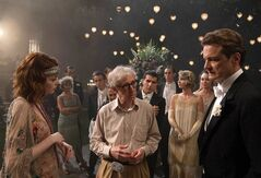 This image released by Sony Pictures Classics shows director Woody Allen, center, with actors Emma Stone, left, and Colin Firth on the set of