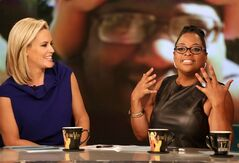 This June 10, 2014 photo released by ABC shows co-host Jenny McCarthy, left, and Sherri Shepherd on the daytime series,