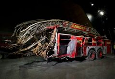 In this May 5, 2014 photo released by the National September 11 Memorial Museum, a firetruck, damaged in the attacks of September 11, 2001, is on display at the New York museum. The long-delayed museum will be dedicated during a ceremony Thursday, May 15, 2014. (AP Photo/ National September 11 Memorial Museum, Jin Lee)
