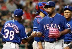 Texas Rangers starting pitcher Jerome Williams hands the ball off to manager Ron Washington as he is taken out in the fifth inning of a baseball game against the Cleveland Indians on Friday Aug. 1, 2014, in Cleveland. (AP Photo/Aaron Josefczyk)