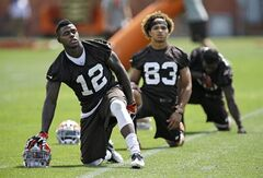 Cleveland Browns wide receiver Josh Gordon (12) stretches before organized team activities at the NFL football team's facility in Berea, Ohio Tuesday, June 3, 2014. Gordon, who is awaiting a possible second NFL drug suspension, was cited for speeding last week and could be running out of chances in Cleveland. (AP Photo/Mark Duncan)