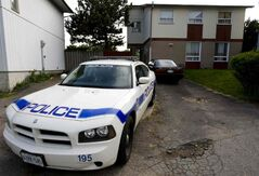 A police car sits in the driveway of the Brampton home of Garfield Boothe, convicted in the murder of his ten-year-old son Shakeil Boothe, Monday, May 30, 2011.