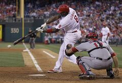 Philadelphia Phillies Ryan Howard connects for an RBI single allowing Chase Utley to score in the fourth inning of a baseball game against the Los Angeles Angels, Tuesday, May 13, 2014, in Philadelphia. (AP Photo/Laurence Kesterson)