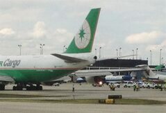 Emergency crews surround an An Eva Air Cargo plane, left, after it clipped the rudder of an American Eagle plane, right, Wednesday, May 30, 2012, at Chicago O'Hare International Airport in Chicago. Federal Aviation Administration spokesman Tony Molinaro says Boeing 747 cargo plane, scheduled to depart for Anchrage, Alaska, clipped the rudder of American Eagle Flight 4265, an Embraer 135, which had just arrived from Springfield, Mo. No injuries were reported. (AP Photo/ Robert Ray)
