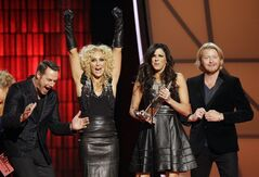 Jimi Westbrook, from left, Kimberly Schlapman, Karen Fairchild and Phillip Sweet, of Little Big Town, accept the award for vocal group of the year at the 46th Annual Country Music Awards at the Bridgestone Arena on Thursday, Nov. 1, 2012, in Nashville, Tenn. (Photo by Wade Payne/Invision/AP)
