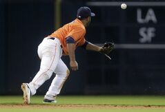 Houston Astros Gregorio Petit can't catch up to a single by Miami Marlins' Casey McGehee during the fourth inning of a baseball game, Friday, July 25, 2014, in Houston. (AP Photo/Patric Schneider)