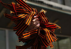 A pro-Russian activist distributes St. George Ribbon to militants at the city hall in Kostyantynivka, 35 kilometres south of Slovyansk, eastern Ukraine, April 28, 2014, after masked militants with automatic weapons seized the hall building.