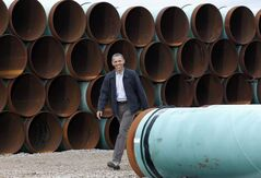 Environmentalists are counting on U.S. President Barack Obama, seen here at the TransCanada yard in Cushing, Okla., last year, to reject the controversial pipeline.