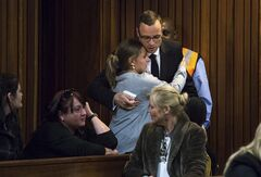 Oscar Pistorius is greeted by a supporter on his arrival in court for his ongoing murder trial in Pretoria, South Africa, Tuesday, May 13, 2014. Pistorius is charged with the shooting death of his girlfriend Reeva Steenkamp on Valentine's Day in 2013. (AP Photo/Daniel Born, Pool)