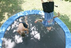 Boys play on a trampoline at Butler's house in Searcy, Ark., on Aug. 2, 2007. Doctors warn that backyard and other recreational trampolines pose a significant risk of injury, especially to younger children. THE CANADIAN PRESS/AP, The Daily Citizen, Samuel Peebles