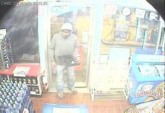 This robbery suspect fled the scene with more than just cash in hand.