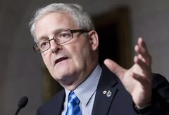 Liberal MP Marc Garneau speaks about the government's omnibus budget bill in the Foyer of the House of Commons on Parliament Hill in Ottawa, Thursday May 10, 2012. THE CANADIAN PRESS/Adrian Wyld