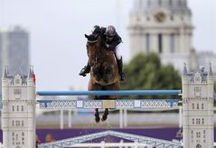 Peter Charles, of Great Britain, rides Vindicat, during the equestrian show jumping team competition at the 2012 Summer Olympics, Monday, Aug. 6, 2012, in London. THE CANADIAN PRESS/AP, David Goldman