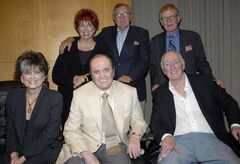 File- This Sept. 5, 2007 file photo shows from left to right, top row actress Marcia Wallace, actor Bill Daily, and actor Jack Riley, bottom row, actress Suzanne Pleshette, actor Bob Newhart, and director Dick Martin pose during a panel discussion at the TV Land 35th anniversary celebration of the Bob Newhart Show in Beverly Hills, Calif. (AP Photo/Dan Steinberg, File)