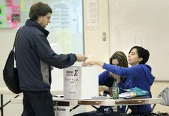 Voting stations were open a 7 a.m. Tuesday. Karl Thomsen cast his ballot at Robert H. Smith School shortly after it opened.