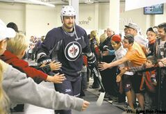 Winnipeg Jet Tanner Glass gets cheered on as he makes his way to the ice.