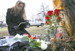 Jacqueline Romano grieves Friday at the site on Wellington Crescent where her 17-year-old daughter, Julia,died in a car crash the day before. 'I don't know how I'll ever get over this,' she said.