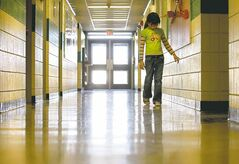 Ruth Bonneville /  Winnipeg Free Press Archives Latisha Smith, 7, walks down a barren hallway at Reynolds School in Prawda. She's one of nine students attending the school.